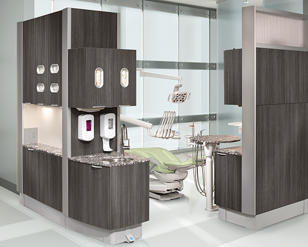 A-dec Inspire dental cabinets and A-dec 400 dental chair with sea mist upholstery