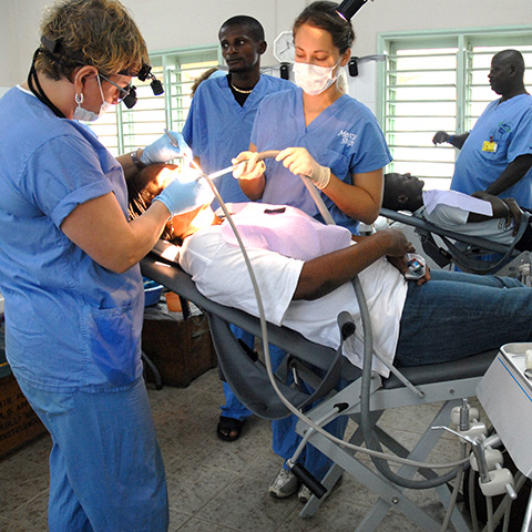 Dentist examines patient in the Mercy Ships dental clinic in Guinea, West Africa.